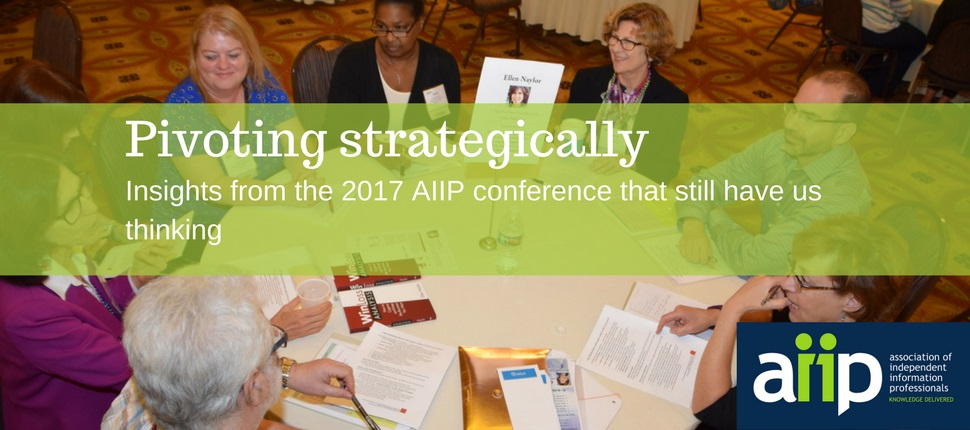 participants at AIIP's 2017 conference in discussion around a table